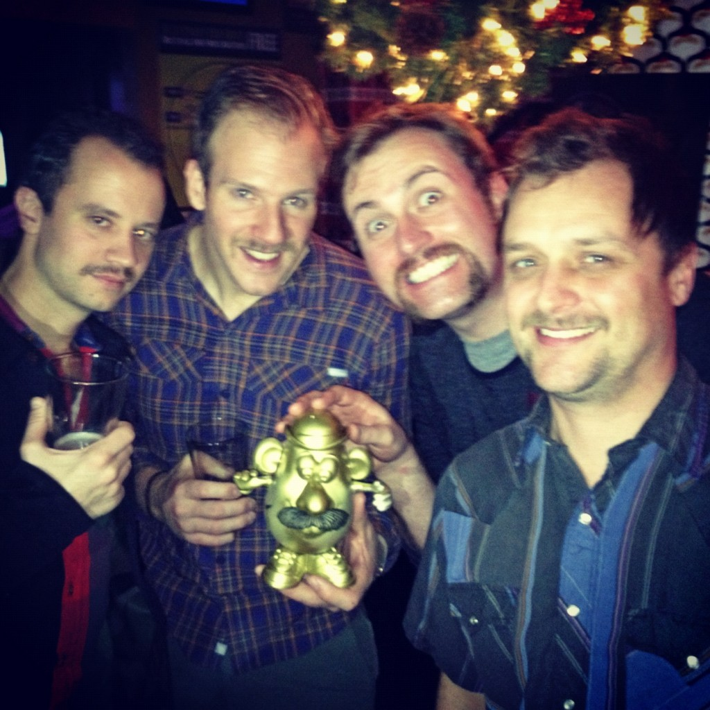 A few members of M.M.G.M. Northwest with our mustachioed prize!